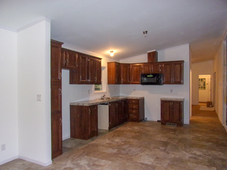 Umber Cabinets, Black Built in Microwave, Autumn Carnival Countertops